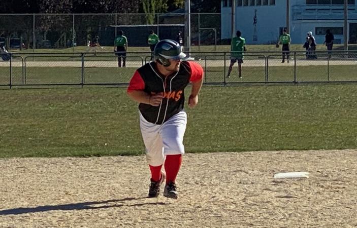 Home runs propel softball victories